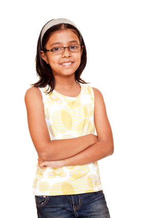 Little girl wearing glasses with arms crossed smiling