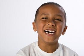 young african american boy smiling with mixed dentition